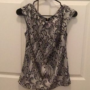Women's black and white printed tops.